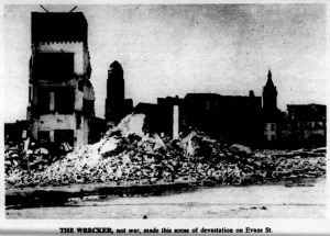 Evans Street Demolition 1950s.  Note City Hall in the rear background of the photo.