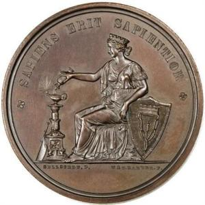"Rear of the Jesse Ketchum Medal - the latin reads ""A Wise Man Will be Wiser"""